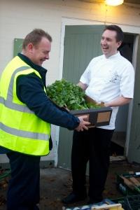 James McKenzie checks the daily veg delivery 01